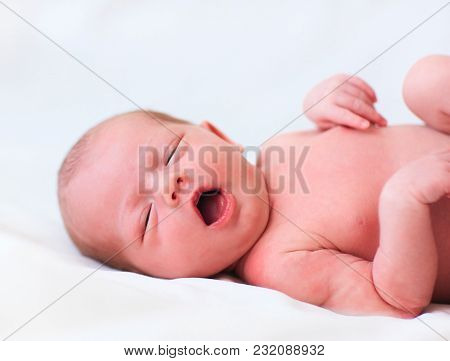 Newborn Baby Girl Laying In Her Bed