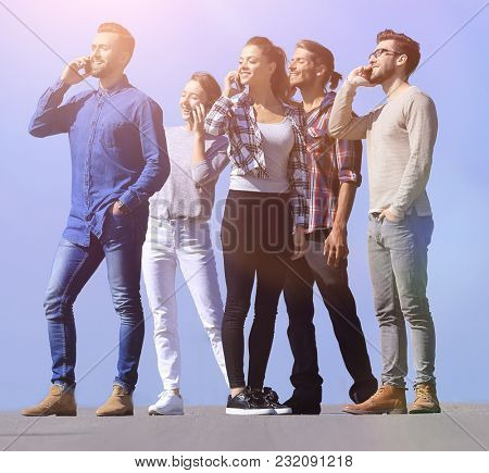 creative team talking on their smartphones