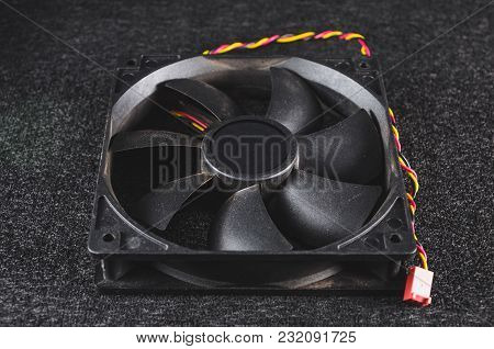Black Pc Fan For Cooling The Case.