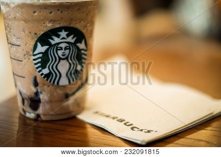 Bangkok, Thailand - January 30, 2018 :  Ice Twix Frappuccino (cappuccino & Frappe) On Brown Table Wi