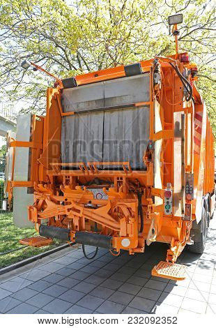 Waste Collection Loader At Rear Of Big Garbage Truck