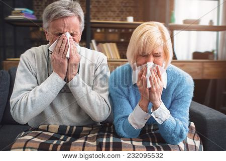 Sick Couple Are Trying To Sneeze In The Napkin. They Caught A Cold And Now Have To Take Some Medicin