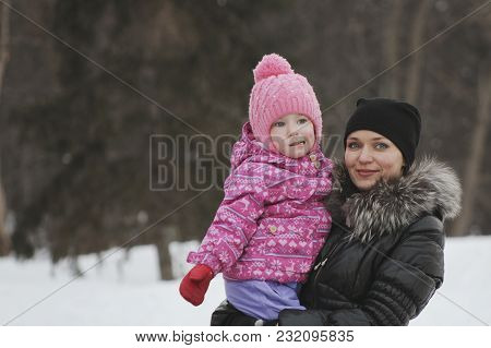 Mom And Her Daughter In The Winter Street, The Woman Holding The Girl In Her Arms, Winter Family Ent