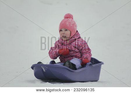 Little Pretty Girl Sledding In A Winter Park, Winter Family Entertainment Concept