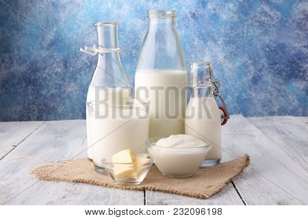 milk products. tasty healthy dairy products on a table on. sour cream in a bowl, cottage cheese bowl