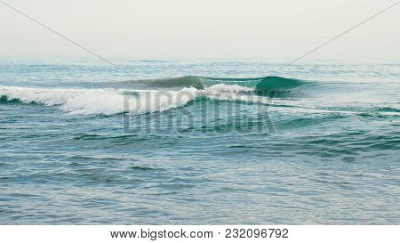 Blue Sea Waves Shimmer In Slow Motion