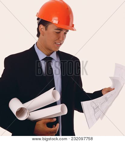 happy young architect portrait with helmet and blueprints