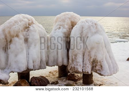 Jetty Pillar Covered With Snow, Looking Like A Mushroom