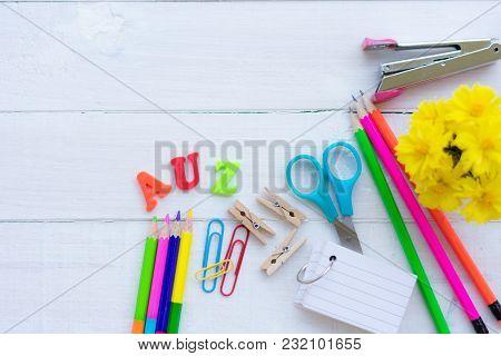 School Office Supplies On A Chalkboard Ground