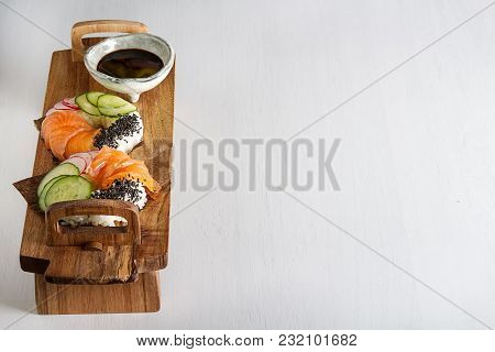 Sushi Donuts Set With Salmon, Vegetarian With Soy Sauce. Sushi Trend. Creative Food. Light Backgroun