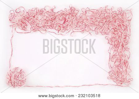 Frame. Red And White Threads Clew  Isolated On A White Background