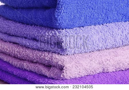 Stack Of Blue And Purple Bathroom Towels Detail