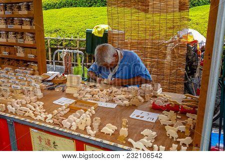 Asakusa, Tokyo, Japan - Aug. 16 2017: An Old Japanese Craftsman Working With Wood, Creating Wooden F