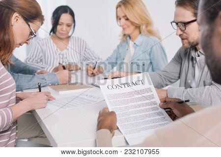 Cropped Shot Of African American Man Holding Contract And People Taking Notes Together