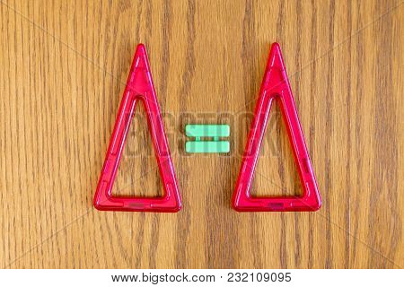 Two Red Triangles And The Equals Sign.