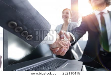 Close-up of two businessmens handshake