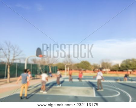 Blurred Motion Teen Boys Playing Basketball At Community Park In Usa