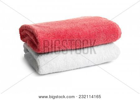 Folded clean terry towels on white background