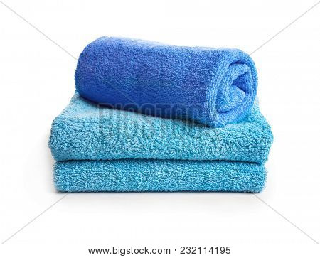 Clean terry towels on white background