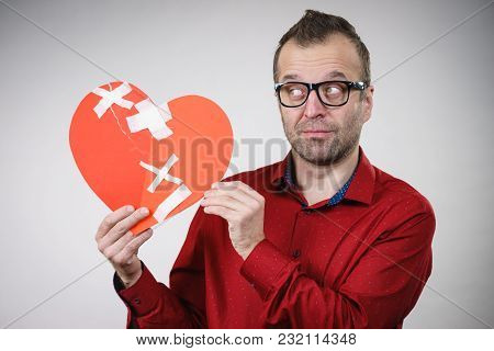 Bad Relationships, Breaking Up, Sadness Emotions Concept. Sad Adult Man Holding Broken Heart, On Gre