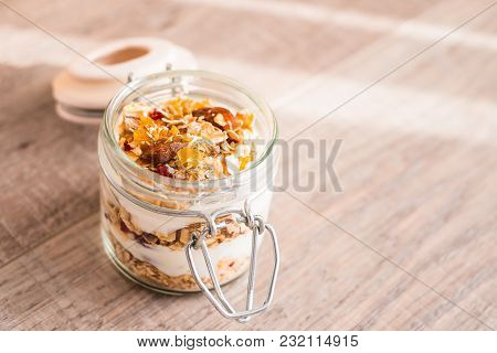 Traditional Breakfast From Switzerland. Jar Of Homemade Muesli Bircher With Plain Yogurt, Toasted Oa