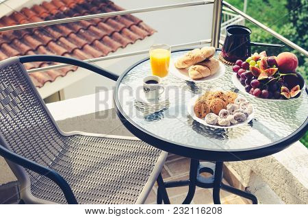Healthy Breakfast On The Table With A Cup Of Coffee And Two Croissants, A Glass Of Orange Juice, Pla