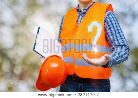 Builder Answers Questions On Blurred Background. Concept Design.