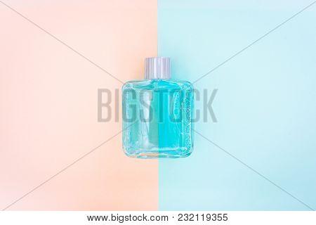 Perfume Bottle On Pastel Background. Minimal Style.