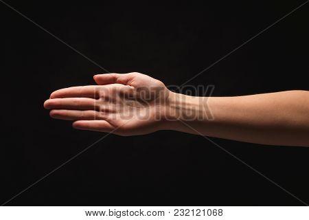 Caucasian Female Hand Taking Something Isolated On Black Background, Copy Space