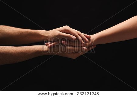 Male And Female Hands Holding Tight Together On Black Isolated Background. Love, Relations, Support,