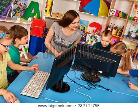 Children computer class us for education and video game. Boys and girls in children's club who spend many hours behind computer monitor harmful to health. Mathematical courses for children.