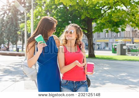 Outdoors Portrait Of Female Friends In The City. Happy Girls In Casual Summer Outfits Having A City