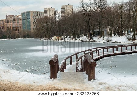 Desolated Pensive Frozen Pond In City Park Is Mysterious And Full Of Sad Harmony So On A Cloudy Wint