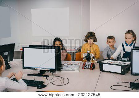 Focused Teen Kids Programming Diy Robot At Machinery Class