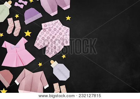 Origami Baby Shower Newborn Clothes On A Blackboard Background