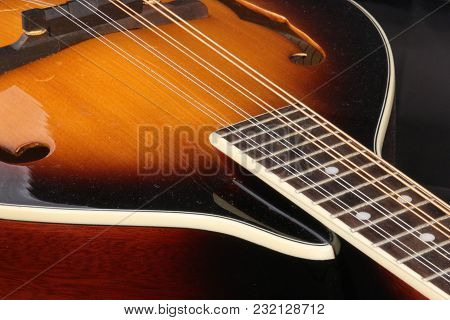 Acoustic Mandolin Waiting To Be Played At Rest