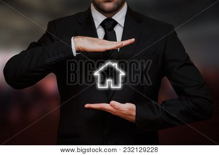 Businessman Offers A New House Between His Hands