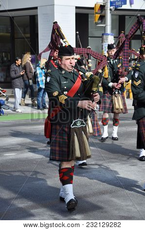 OTTAWA, CANADA - MAR. 10, 2012: Military Bagpipers in Saint Patrick's Day Parade in Ottawa, Ontario, Canada.