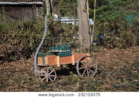 A Colorful Wagon For Decoration In A Garden