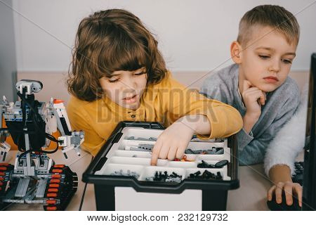 Concentrated Kids Constructing Diy Robot, Stem Education Concept