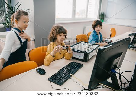 Concentrated Children Programming Robots At Class, Stem Education Concept