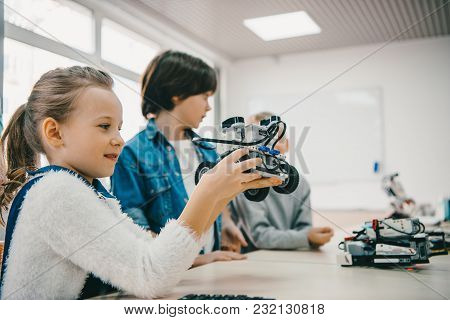Little Kids Sitting At Class With Diy Robot, Stem Education Concept