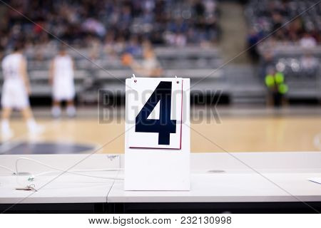fourth quarter of basketball game sign on table