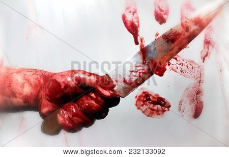 Horror Photo Of A Killer Bloody Hand With Sharp Kitchen Knife Behind A Blurred Glass With Bloody Han