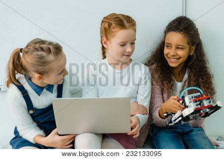Group Of Happy Schoolgirls Working With Laptop Together On Stem Education Class