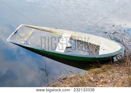 Sunken Rowing Boat In A Lake At Magdeburg In Germany