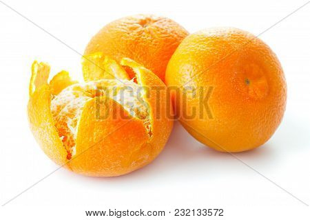 Three Ripe Tangerines Isolated On White Background
