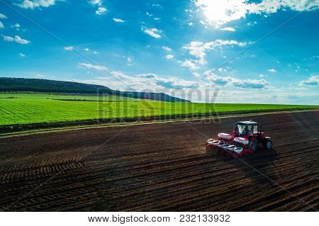 Aerial View Of Tractors Working On The Harvest Field