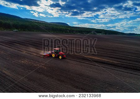 Agriculture - Aerial Drone View Of Harvest Fields With Tractor