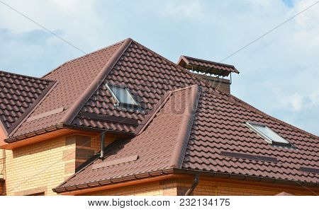 Metal Roof With Modern House Attic Construction With Roof Guttering And Attic Skylight Window.  Atti